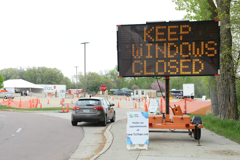 A sign at the entrance of the COVID-19 test site in Sioux City, Iowa, instructs motorists to keep their windows closed as they make their way to a temporary drive-through test site at the Western Iowa Technical Community College parking lot, May 7, 2020.
