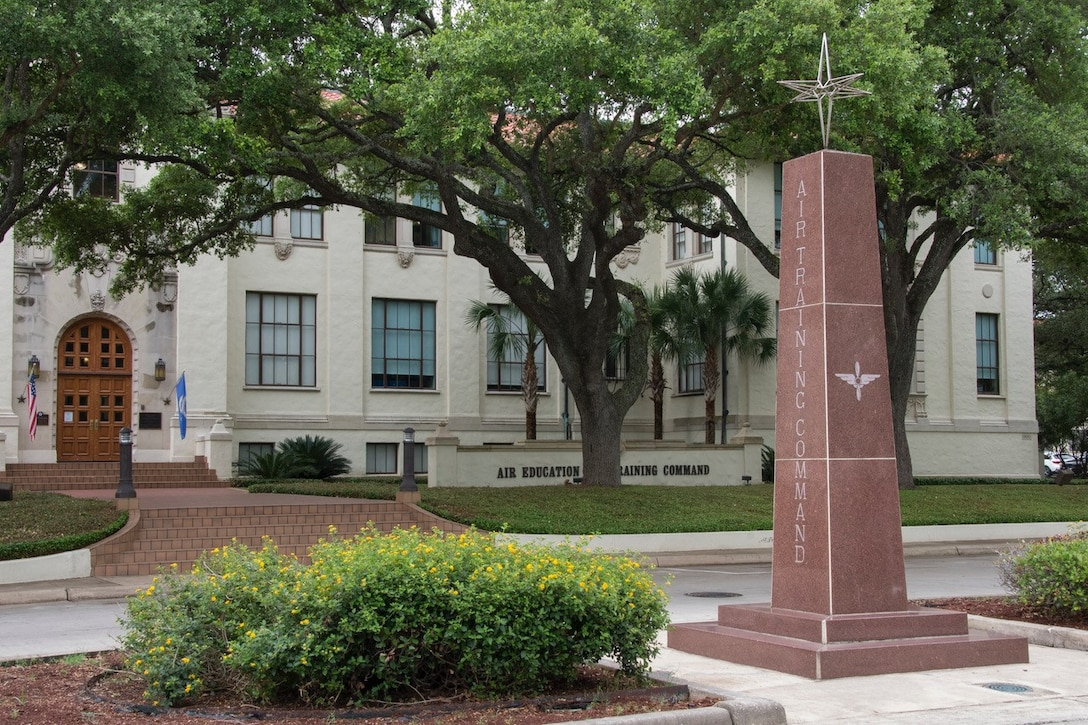 A picture of the Instructor Monument wit the AETC headquarters building in the background.