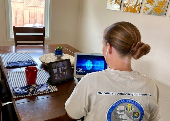 Senior Master Sgt. Rachel Martinez, 349th Air Mobility Wing public affairs specialist, attends a virtual meeting during the May drill weekend May 17, 2020, in Monterey, Calif. The 349th AMW held the May UTA virtually to safeguard Airmen from COVID-19.