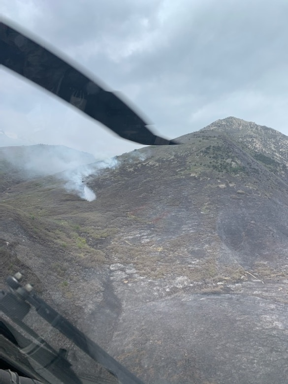A Black Hawk helicopter from 2nd General Aviation Support Battalion, 211th Aviation Regiment, Utah National Guard drops water on the Saddle Fire in Midway, Utah, May 14, 2020.