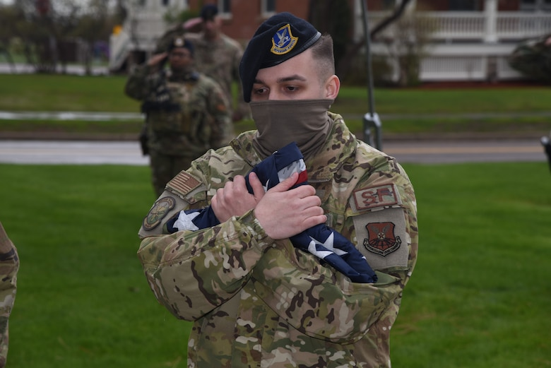 Airman holds flag