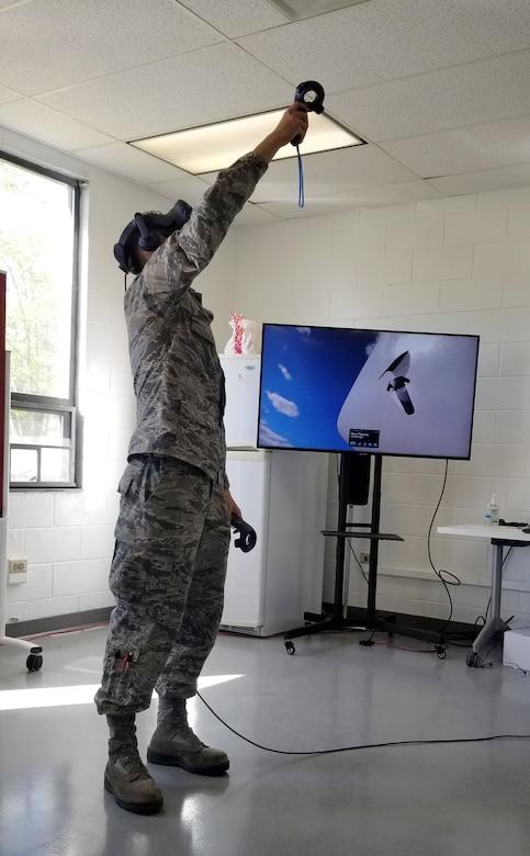 Airmen wearing goggles