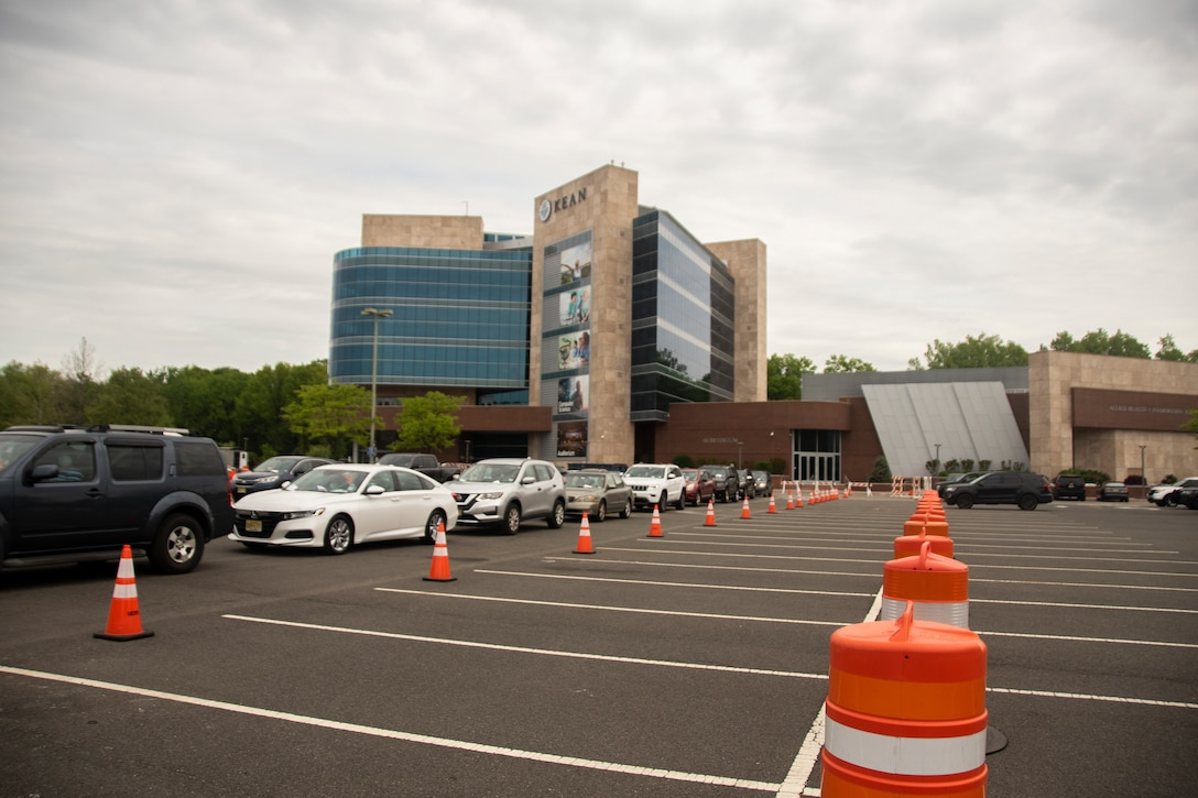 Cars line up for testing at the Union County COVID-19 drive-through, testing site located at Kean University in Union, N.J., May 18, 2020.  The New Jersey National Guard is working with Union County to provide security and traffic control at Kean University. (U.S. Air National Guard photo by Senior Airman Julia Santiago)