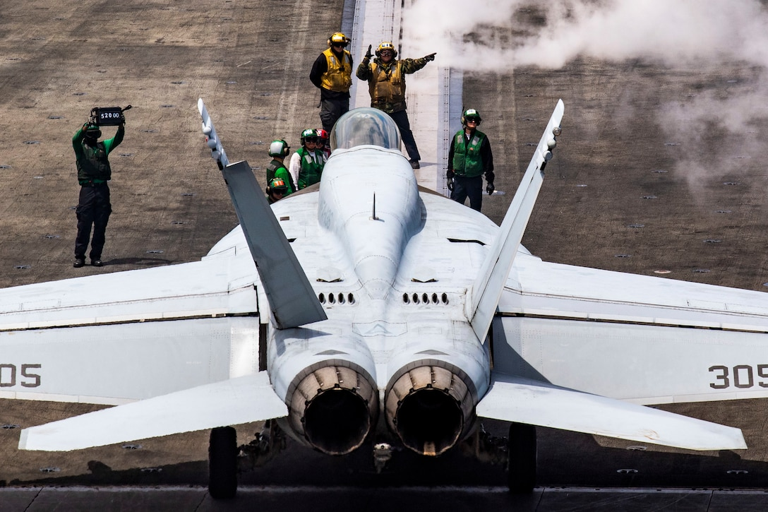 """An F/A-18E Super Hornet, assigned to the """"Knighthawks"""" of Strike Fighter Squadron 136, lines up on a catapult on the flight deck of the Nimitz-class aircraft carrier USS Harry S. Truman (CVN 75) in the Atlantic Ocean May 12, 2020. The Harry S. Truman Carrier Strike Group remains at sea in the Atlantic as a certified carrier strike group force ready for tasking in order to protect the crew from the risks posed by COVID-19, following their successful deployment to the U.S. 5th and 6th Fleet areas of operation. Keeping HSTCSG at sea in U.S. 2nd Fleet, in the sustainment phase of OFRP, allows the ship to maintain a high level of readiness during the global COVID-19 pandemic. (U.S. Navy photo by Mass Communication Specialist 2nd Class Tamara Vaughn)"""