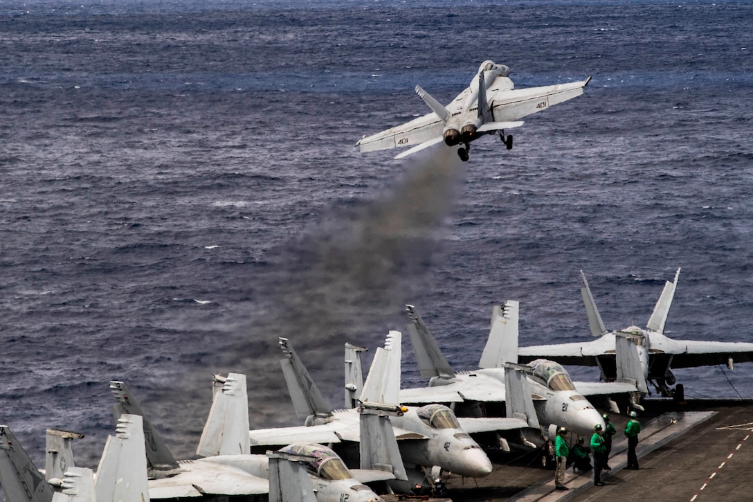 """An F/A-18E Super Hornet, assigned to the """"Sunliners"""" of Strike Fighter Squadron (VFA) 81, launches from the flight deck of the Nimitz-class aircraft carrier USS Harry S. Truman (CVN 75) in the Atlantic Ocean May 12, 2020. The Harry S. Truman Carrier Strike Group remains at sea in the Atlantic as a certified carrier strike group force ready for tasking in order to protect the crew from the risks posed by COVID-19, following their successful deployment to the U.S. 5th and 6th Fleet areas of operation. Keeping HSTCSG at sea in U.S. 2nd Fleet, in the sustainment phase of OFRP, allows the ship to maintain a high level of readiness during the global COVID-19 pandemic. (U.S. Navy photo by Mass Communication Specialist 2nd Class Tamara Vaughn)"""
