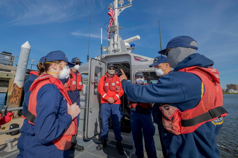 Boatswains Mate 3rd class Max Alderman provides a risk assessment brief to crew members prior to Man Overboard training May 12, 2020, at Coast Guard Station Charleston, S.C.