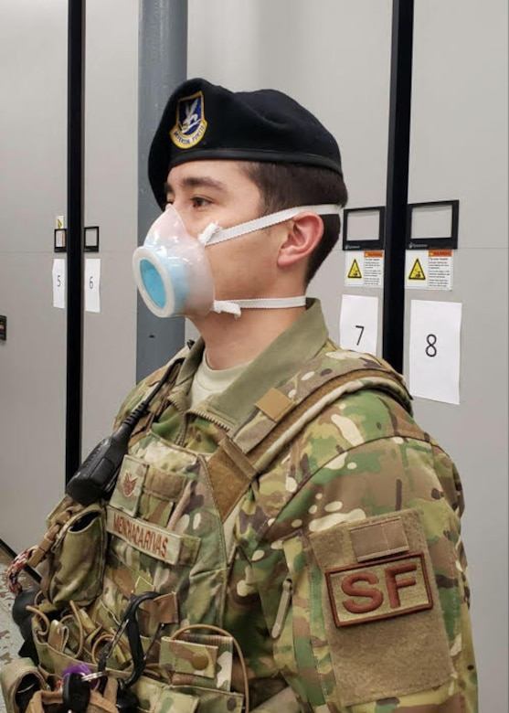 An 11th Security Support Squadron member wears a mask received through a pilot initiative called the Air Force Rapid Agile Manufacturing Platform at Joint Base Andrews, Md., May 15, 2020. The framework is designed to keep the Air Force supply system independent of the civilian medical market. (U.S. Air Force courtesy photo)