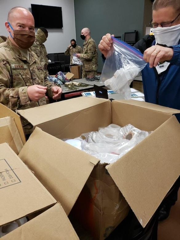 Members of the 11th Security Support Squadron unbox personal protective equipment received through a pilot initiative called the Air Force Rapid Agile Manufacturing Platform at Joint Base Andrews, Md., May 15, 2020. The framework is designed to keep the Air Force supply system independent of the civilian medical market. (U.S. Air Force courtesy photo)
