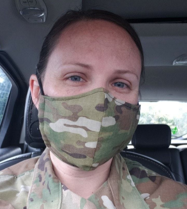 U.S. Air Force Staff Sgt. Rachel Yandon, a radio frequency transmission systems apprentice assigned to the 225th Support Squadron, Washington Air National Guard, wears a face mask like the ones she donated to mission essential personnel of the Western Air Defense Sector May 7, 2020.  Yandon also sewed and donated 150 masks to an Alabama hospital.