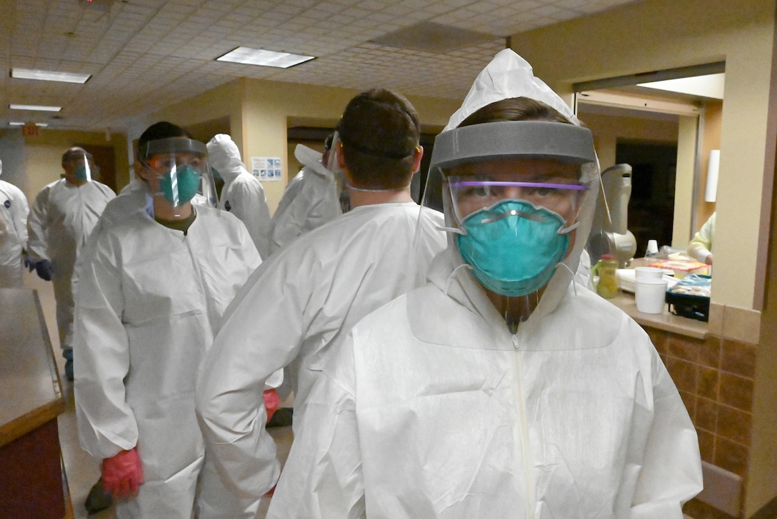 Photo of Airman 1st Class Alexia Durkop in personal protective equipment as she joins several North Dakota Air National Guard members preparing to deep clean a congregate living facility, Fargo, N.D., May 18, 2020.