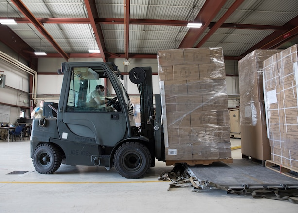 Senior Airman Peter Zuniga, 151st Logistics Readiness Squadron Aerial Port, operates a forklift while loading aircraft pallets of donated goods in preparation for airlift to the nation of Ecuador, April 9, 2020 at Roland R. Wright Air National Guard Base, Utah