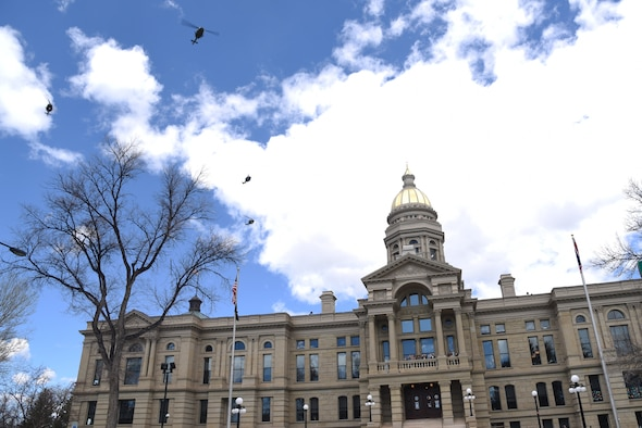 Hueys fly over state capitol