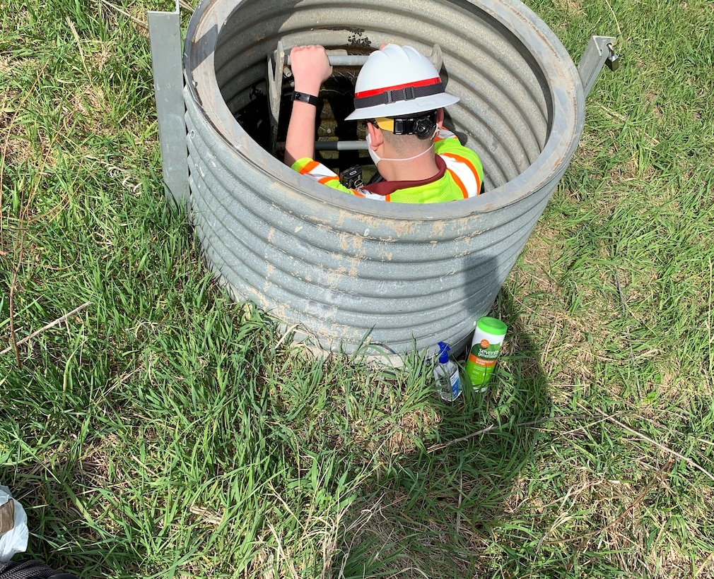Narturi Narciso, engineer in training, U.S. Army Corps of Engineers, Omaha District,enters a conduit at a conduit to inspect the drainage system at Salt Creek Site 2, Olive Creek Dam, Neb., to check for erosion and if the outlet channel in satisfactory condition May 1. This was the first inspection the dam safety program conducted since the COVID-19 pandemic began.