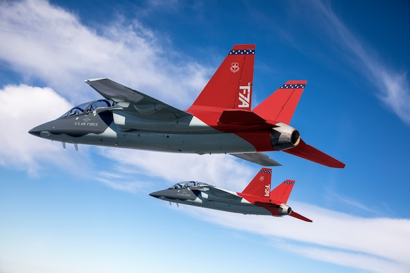 Two T-7A test jets soar over St. Louis during a test flight, April 24, 2017. On April 30, 2020, the T-7A Test Team executed the first real-time Distributed Test Operations with the T-7A in a mission control room at Ridley Mission Control Center at Edwards AFB. The T-7A Red Hawk is part of the new advanced pilot training system for the U.S. Air Force that will train the next generation of pilots and is scheduled to replace the current T-38.  (Credit: E.Shindelbower/BOEING COMPANY ● ALL RIGHTS RESERVED)