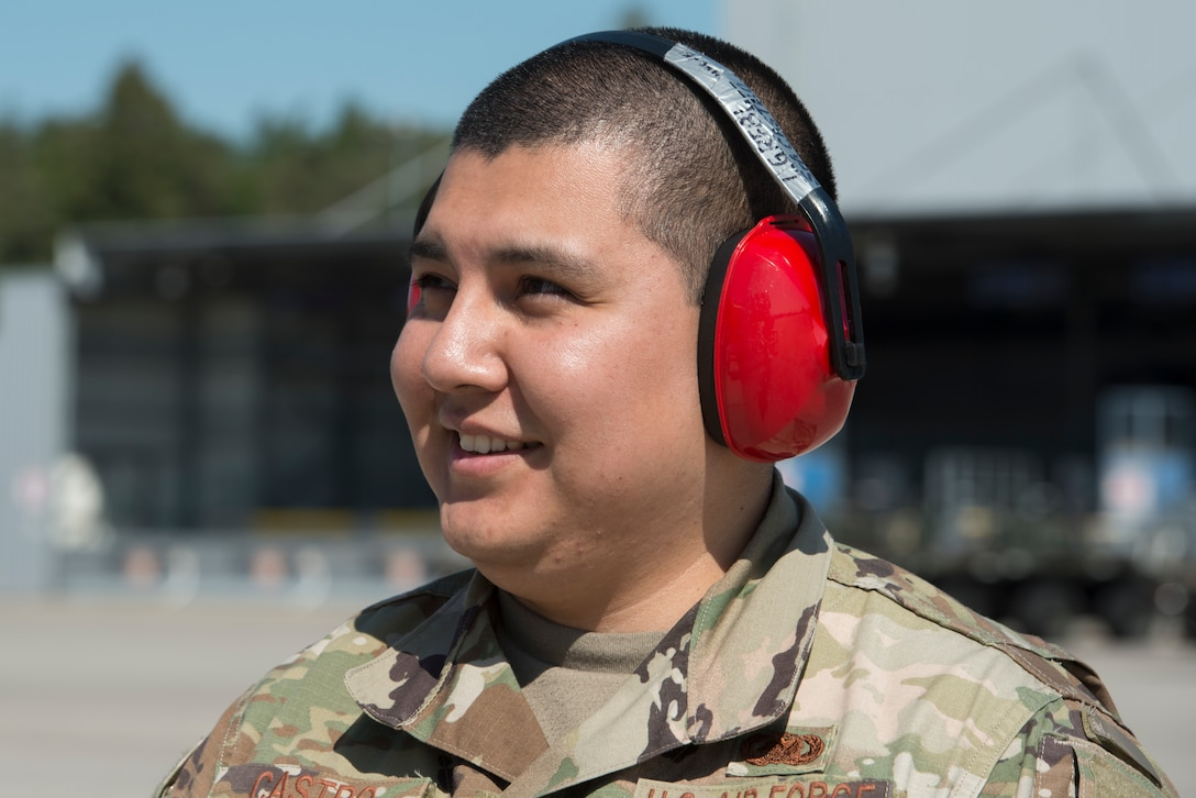 A photo of an Airmen smiling.