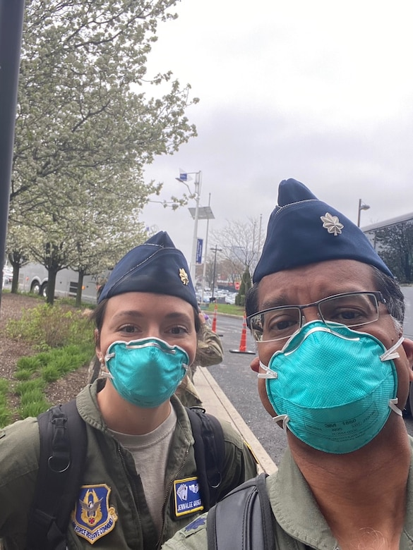 Maj. (Dr.) Jennalee Gaiser and Lt. Col. (Dr.) Raja Talati, from the 927th Air Refueling Wing, board a bus in New York City to report for duty at Jacobi hospital in the Bronx. (courtesy photo)