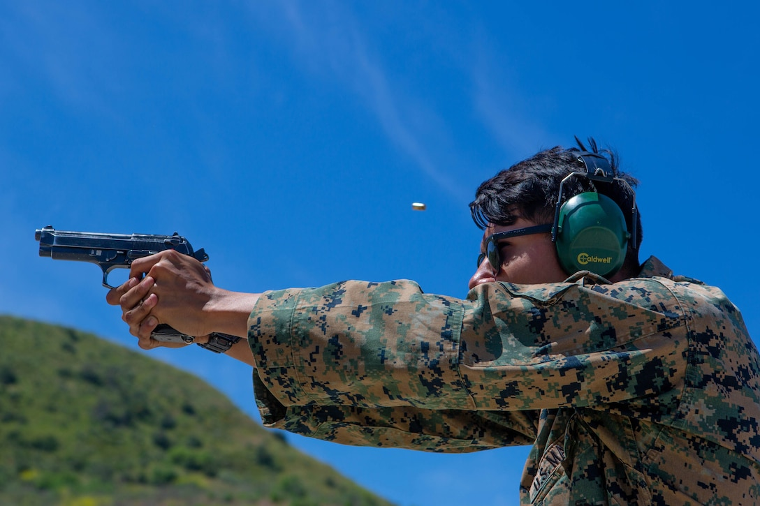 A U.S. Marine fires his M9 pistol during a live fire range on Camp Pendleton, California, May 7, 2020.