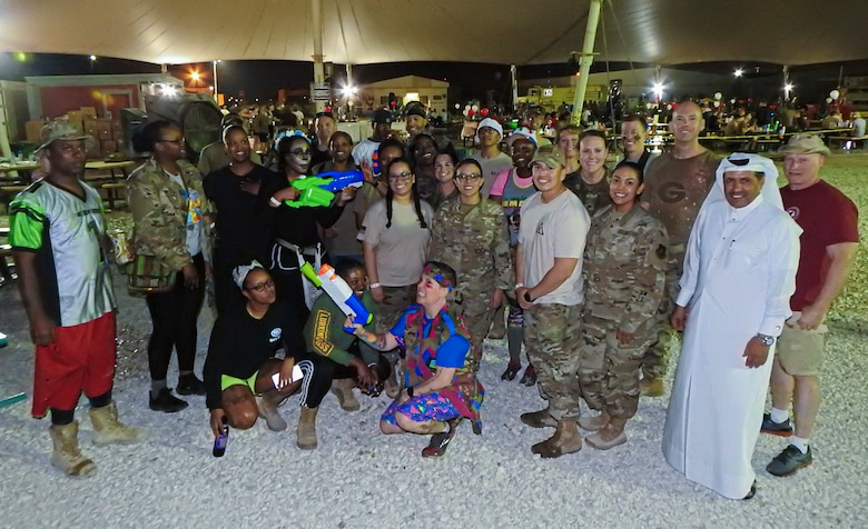 Members with the 379th Expeditionary Force Support Squadron pose for a photo during the 379th Expeditionary Mission Support Group Combat Dining Dec. 11, 2019, at Al Udeid Air Base, Qatar. (Courtesy Photo)