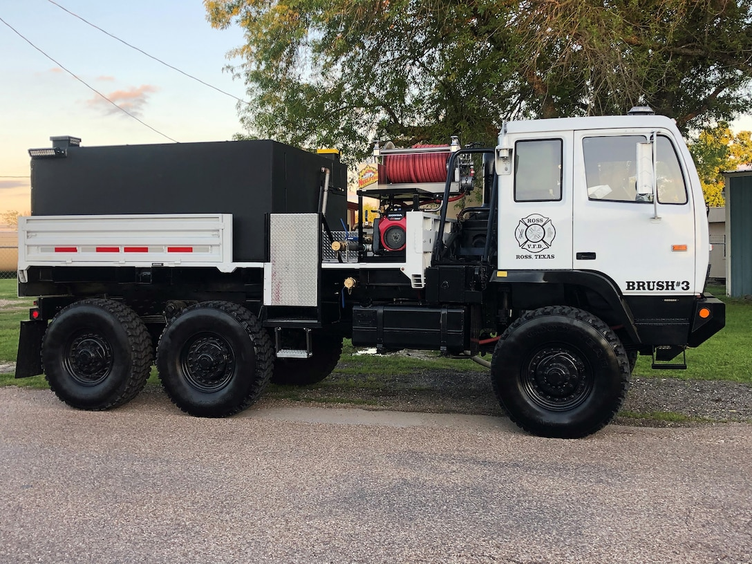 A former military truck now stands ready to help fight fires in Ross, Texas after being converted into a firetruck