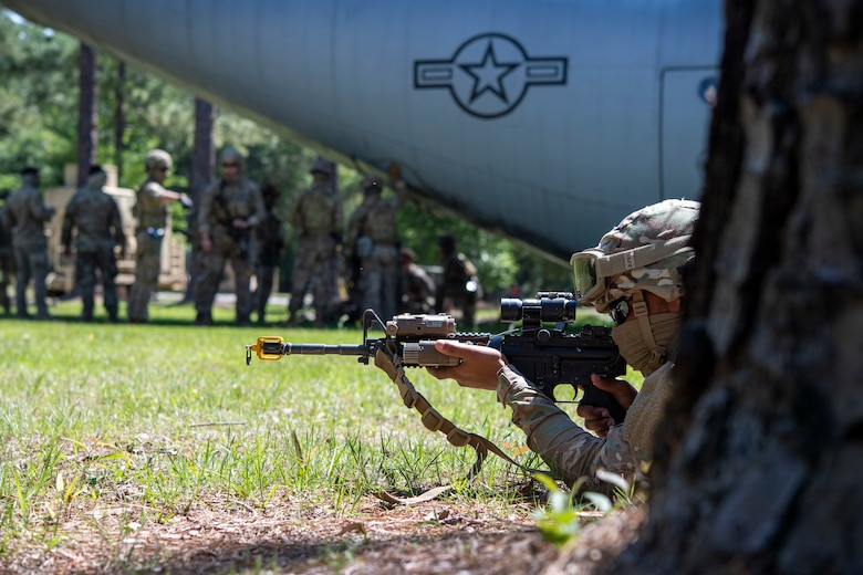Airman keeps security during a training scenario