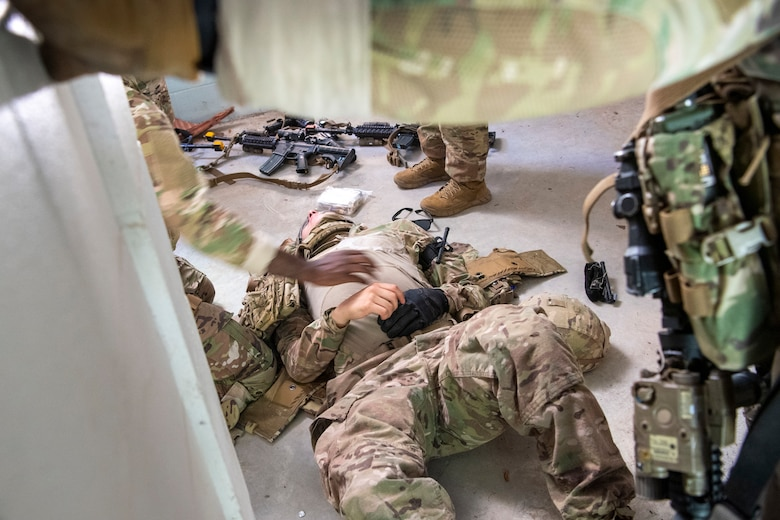 An Airman acts as a casualty during a training scenario