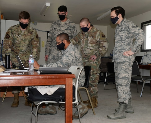 Contracting Airmen work on contracts
