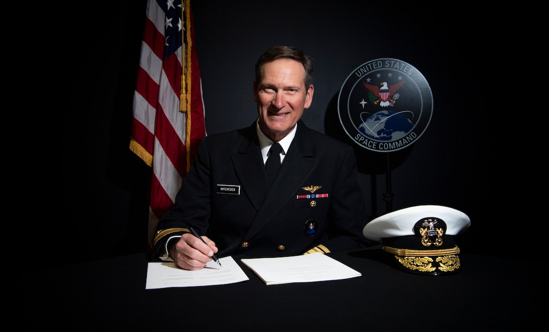 Rear Adm. Marcus A. Hitchcock, USSPACECOM Director of Strategy, Plans and Policy, signs a space data sharing Memorandum of Understanding between the United States and the Republic of Peru recently at Peterson Air Force Base, Colorado.