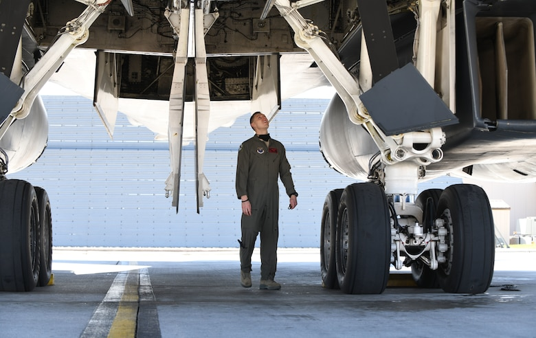 An aviator assigned to the 34th Bomb Squadron at Ellsworth Air Force Base, S.D., conducts pre-flight checks on a B-1B Lancer prior to launching in support of a Bomber Task Force mission in the U.S. European Command area of responsibility May 19, 2020. BTF missions are representative of the U.S. commitment to integrate with NATO and allied partners to ensure regional security. (U.S. Air Force photo by Airman 1st Class Christina Bennett)