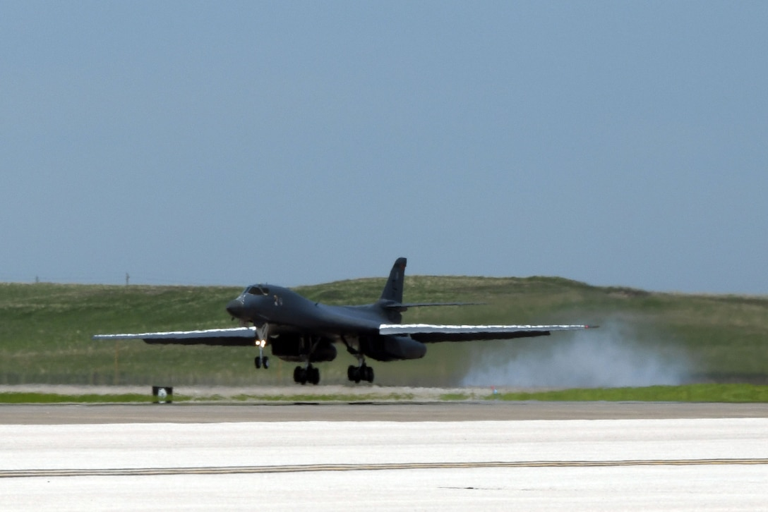 A 34th Bomb Squadron B-1B Lancer lands on the runway at Ellsworth Air Force Base, S.D., May 20, 2020, after the completion of a long-range, long-duration Bomber Task Force mission within the U.S. European Command area of responsibility. BTF missions provide opportunities to work and train with U.S. allies and partners, while strengthening capabilities by familiarizing aircrew with air bases and operations in different parts of the world. (U.S. Air Force photo by Airman 1st Class Christina Bennett)
