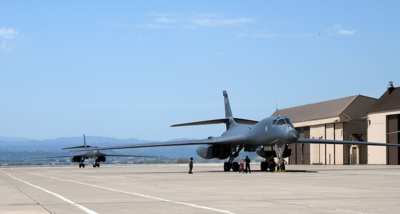 Two B-1B Lancers assigned to the 34th Bomb Squadron taxi in to the apron on the flight line at Ellsworth Air Force Base, S.D., May 20, 2020.  The two bombers completed a long-range, long-duration Bomber Task Force mission within the U.S. European Command area of responsibility. BTF missions are representative of the U.S. commitment to integrate with NATO and allied partners to ensure regional security. (U.S. Air Force photo by Airman 1st Class Christina Bennett)