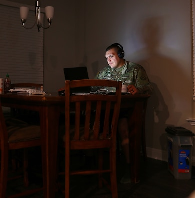 Texas Army National Guard Spc. Jason Archer, attached to the 100th Mobile Public Affairs Detachment, 71st Troop Command, logs on to a videoconference at his home in Leander, Texas, April 6, 2020. Archer's unit continued training remotely during the state ordered shelter-in-place.