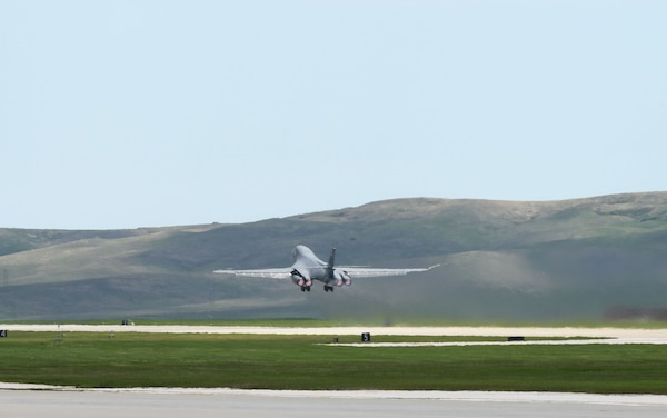 A 34th Bomb Squadron B-1B Lancer launches from Ellsworth Air Force Base, S.D., May 19, 2020, to conduct a long-range, long-duration Bomber Task Force mission within the U.S. European Command area of responsibility. BTF missions provide opportunities to work and train with U.S. allies and partners, while strengthening capabilities by familiarizing aircrew with air bases and operations in different parts of the world. (U.S. Air Force photo by Airman 1st Class Christina Bennett)