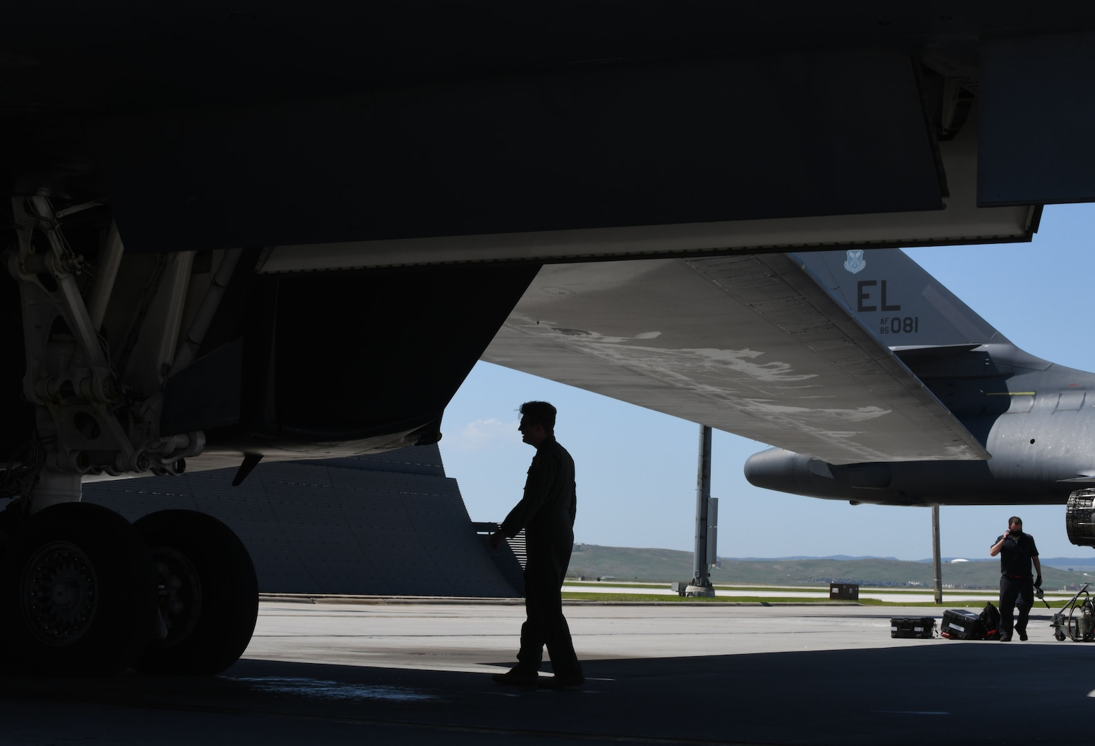 Pre-flight checks are conducted prior to a B-1B Lancer launch from Ellsworth Air Force Base, S.D., May 19, 2020, in support of a Bomber Task Force mission within the U.S. European Command area of responsibility. BTF missions are a visible demonstration of the United States' capability of extended deterrence and commitment to the collective defense of the NATO alliance. (U.S. Air Force photo by Airman 1st Class Christina Bennett)