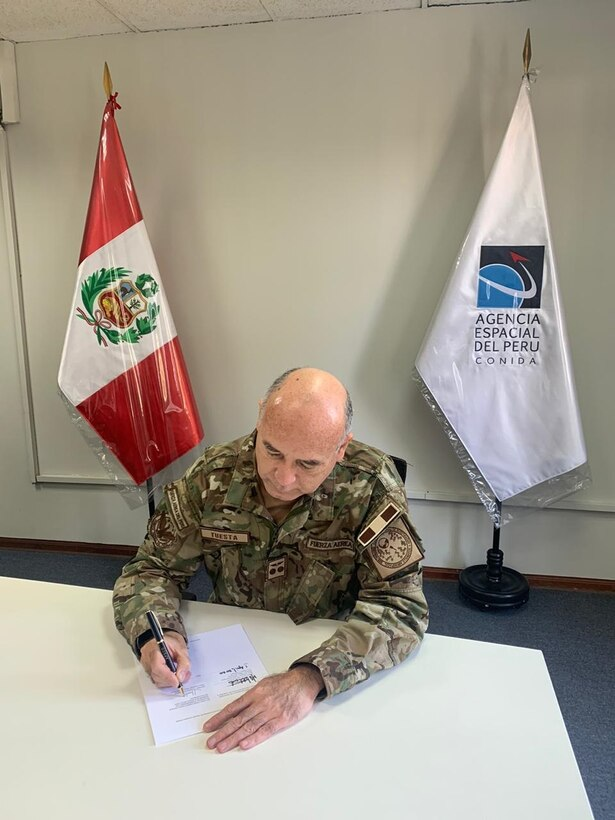 Maj. Gen. Javier Tuesta Marquez, National Commission on Aerospace Research and Development (CONIDA), Republic of Peru, signs a space data sharing Memorandum of Understanding between his country and the United States recently.