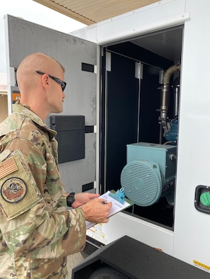 Senior Airman David Walker, 647th Civil Engineer Squadron pest management journeyman, performs maintenance on the thermal bed bug treatment equipment on Joint Base Pearl Harbor-Hickam, Hawaii, May 18, 2020. The equipment is inspected monthly to ensure it is up to standard and working correctly. (Courtesy photo)