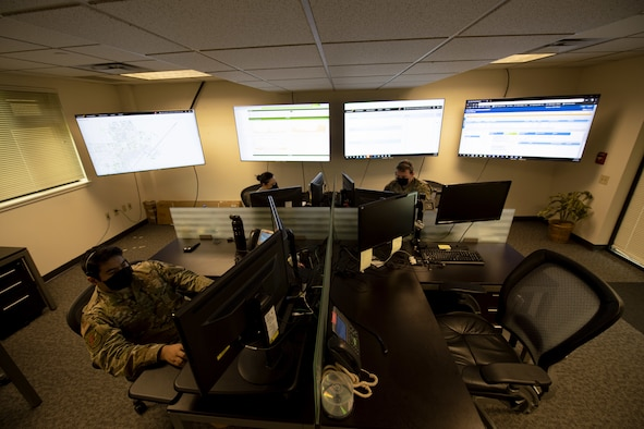 Airmen assigned to the 60th Communications Squadron work behind computers to keep Travis' mission operating.