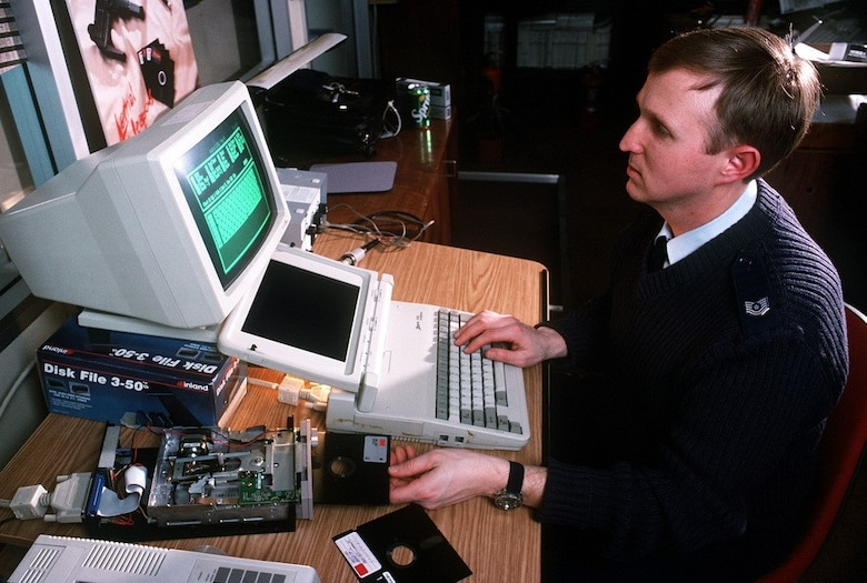 OSI Special Agent Ed Cutchins inserted a repaired floppy disk into the drive to review its data. (Photo courtesy U.S. National Archives)