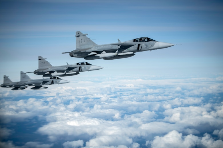 Swedish Armed Forces Gripens fly in formation during a Bomber Task Force Europe mission over Sweden, May 20, 2020. Training with our NATO allies and theater partner nations contributes to enhanced resiliency and interoperability and enables us to build enduring relationships necessary to confront the broad range of global challenges. (U.S. Air Force photo by Tech. Sgt. Emerson Nuñez)
