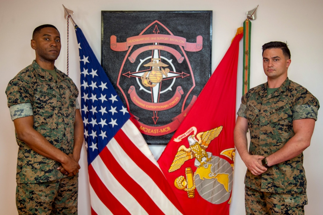U.S. Marine Corps Staff Sgt. Hubert Robertson, left, S-3 assistant training chief and Sgt. Christopher Whitby, right, watch chief with Provost Marshal Office, both with Headquarters and Support Battalion, Marine Corps Installations East-Marine Corps Base Camp Lejeune, pose for a photo at building 8 on Marine Corps Base Camp Lejeune, North Carolina, May 13, 2020. Robertson and Whitby collaborated together and presented a new digital classroom for Marines attending Lance Corporals Leadership and Ethics Seminar. (U. S. Marine Corps photo by Cpl. Karina Lopezmata)