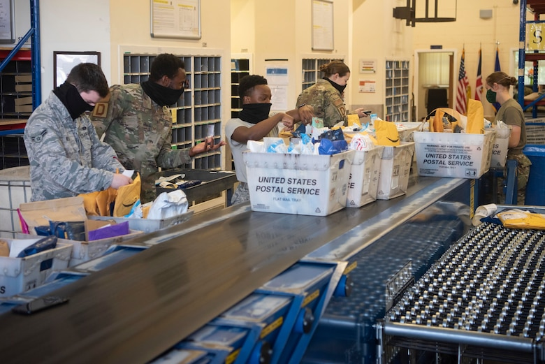 Postal clerk Airmen inventory packages at the post office at RAF Mildenhall, England, May 19, 2020. Newly arrived packages are in-processed to ensure accountability of mail and alert customers to when their order has arrived. (U.S. Air Force photo by Airman 1st Class Joseph Barron)