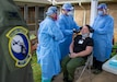 Col. Scott Coradi (left), 111th Medical Group commander and medical adviser for Pennsylvania Task Force South trains members of Task Force Ghostrider, Spc. Joshua Vargo (center) and Spc. Kristien Quintanilla (right) on proper procedures how to administer a COVID-19 test in Lancaster, Pa., on May 19, 2020. Under guidance from the Pennsylvania Department of Health, and monitored by CDC officials, Pennsylvania National Guard members with Task Force Ghostrider launched a point prevalence sampling strike team in Lancaster. The mission is designed to identify possible risks of exposure to COVID-19 by testing the entire staff and residents for the virus. This is the first in the pilot program that will reach out across the state. (U.S. Air National Guard photo by Master Sgt. George Roach)