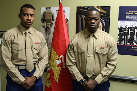 Montgomery natives Pfc. Adarious Gibbs and Lance Cpl. Isaiah Walker-Trammell pose for a photo in RSS Montgomery's recruiting office. Gibbs and Walker-Trammell will spend their time home assisting recruiters during the holidays.
