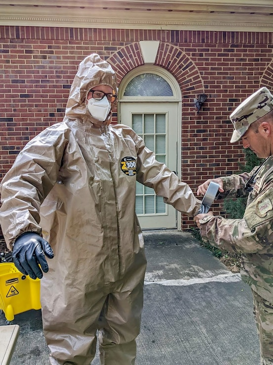 U.S. Air Force Staff Sgt. Scott Shalek, an E-8C Joint STARS aircraft aerospace propulsion mechanic with the 116th Maintenance Squadron, Georgia Air National Guard, dons personal protective equipment before sanitizing a long-term care facility in Macon, Georgia, May 8, 2020. Georgia National Guard infection control teams supported COVID-19 relief efforts throughout Georgia. (U.S. Air National Guard courtesy photo)
