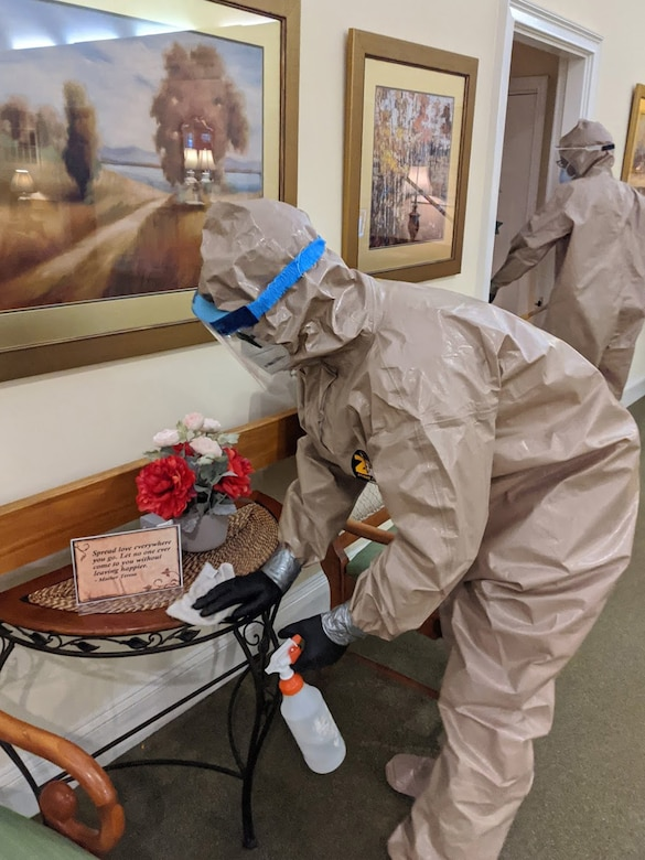 U.S. Air Force Staff Sgt. Scott Shalek, an E-8C Joint STARS aircraft aerospace propulsion mechanic with the 116th Maintenance Squadron, Georgia Air National Guard, sanitizes a long-term care facility in Macon, Georgia, May 8, 2020. Georgia National Guard infection control teams supported COVID-19 relief efforts throughout Georgia. (U.S. Air National Guard courtesy photo)