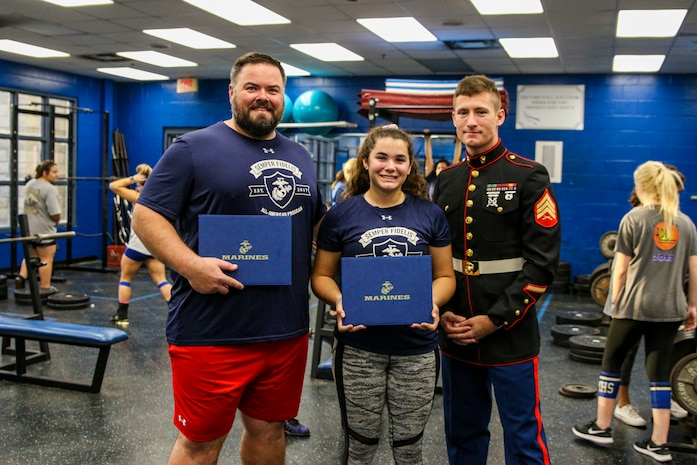 Sgt. Jesse Hoffman, a recruiter with Recruiting Substation Ponte Vedra, Recruiting Station Jacksonville, presented Lauren Prosuch, a senior at Pedro Menendez High School, an award for being selected and attending the Semper Fidlis All-American Program at Pedro Menendez High School, St. Augustine, Florida on Oct. 30, 2019. SFAAP is held during the summer in Washington, D.C. and recognizes high school students who face life's battles with the conviction and determination to succeed. (U.S. Marine Corps photo by Cpl. Mike Hernandez)