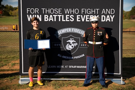 Trey Putnam III of Langtree Charter Academy in Mooresville, North Carolina receives a congratulatory certificate for attending the 2019 Semper Fidelis All-American Program Battles Won Academy, July 11-15, in Washington, D.C.