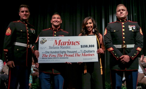 Stephanie Mandez, a Cairo High School student, is presented a Navy Reserves Officer Training Corps Scholarship at Cairo High School Senior's Awards Night, April 29, 2019, at Cairo High School in Cairo, Georgia. Mandez is one of eight applicants to receive this scholarship in RS Jacksonville's area of operation. (U.S. Marine Corps Photo by Cpl. Mike Hernandez)