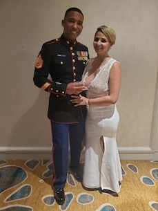 Staff Sgt. Adalberto Dominguez, the staff noncommissioned officer-in-charge of Marine Recruiting Station Miami, and his wife, Ashley Dominguez, pose for a photo during Marine Corps Recruiting Stations Fort Lauderdale's 244th Marine Corps Birthday Ball celebration Nov. 9, 2019. (Courtesy photo by Staff Sgt. Adalberto Dominguez)
