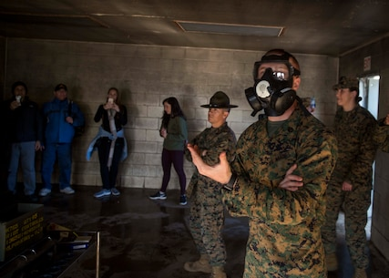 U.S. Marine Corps Staff Sgt. Matthew Parker, a chemical, biological, radiological and nuclear defense chief with Weapons and Field Training Battalion, demonstrates gas chamber procedures to attendees of the Educators Workshop aboard Marine Corps Recruit Depot Parris Island, South Carolina, Jan. 31, 2019. These educators traveled from Recruiting Station Fort Lauderdale to experience the Educators Workshop. The workshop allows educators to have an inside look at educational benefits and career opportunities in the Marine Corps. (U.S. Marine Corps photo by Lance Cpl. Jack A. E. Rigsby)