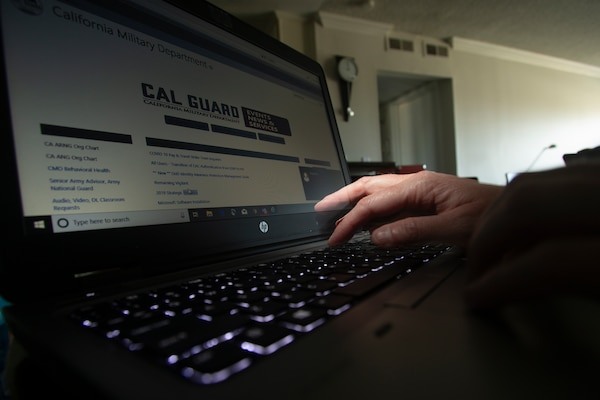 A California National Guard full-time technician works from home May 20, 2020, at Huntington Beach, California. Many Cal Guard full-time staff members are teleworking during the COVID-19 pandemic as a way of protecting themselves, their coworkers and high-risk family members from the virus.